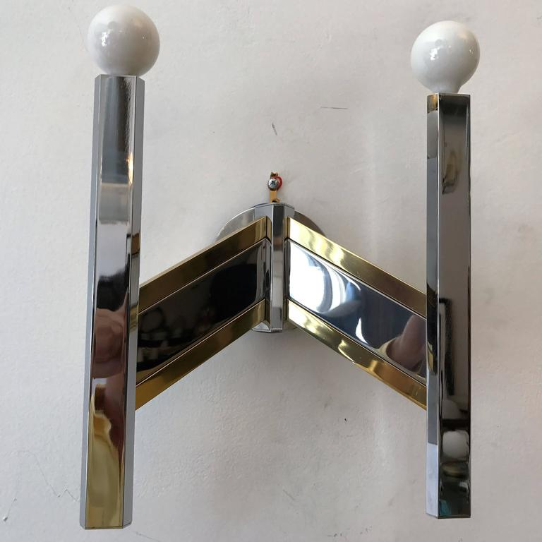 A sleek 1960s Italian sconce in polished chrome and brass by the famed lighting company, Sciolari. Newly rewired.