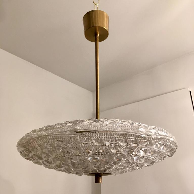 A pair ofSwedish 1950s thick textured two-piece Crystal pendants  designed by Carl Fagerlund for Orrefors with aged brass fittings.