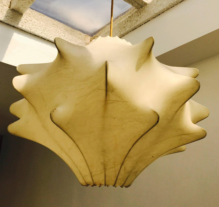 A 1960s sculptural Italian spun resin pendant designed by Achille Castiglioni. Newly Rewired with a gold rayon cord and brass canopy.