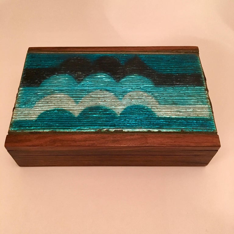 An enamel box in shades of blue over walnut by the famed Italian firm. Del Campo. Signed.
