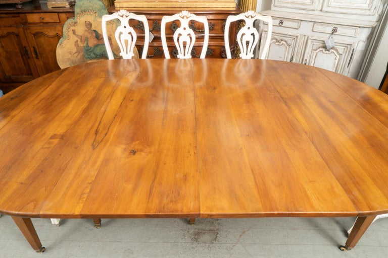 """Beautiful period directoire walnut extension table shown with two leaves. There are three extra finished leaves each adding 19.5"""" to the total length."""