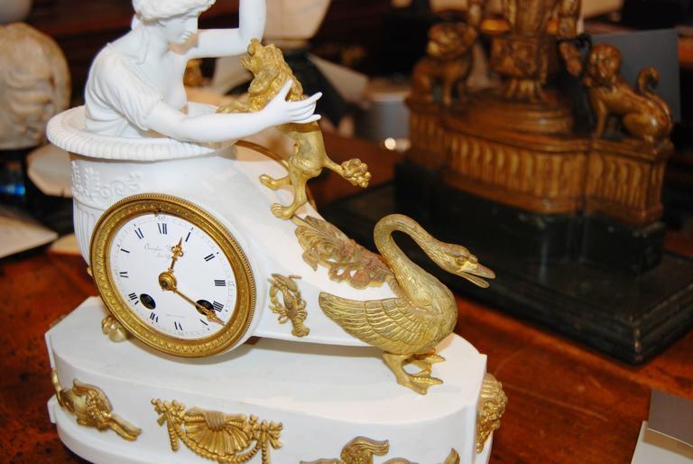 Empire bisque and bronze doré' mantel clock.