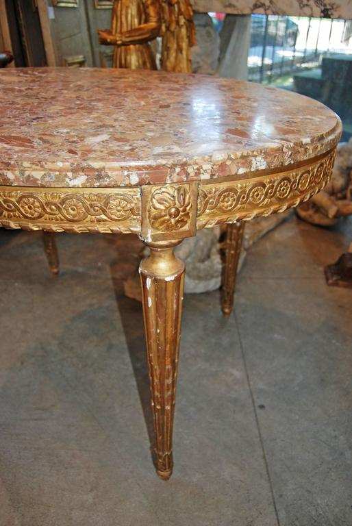 Beautifully carved giltwood center table.