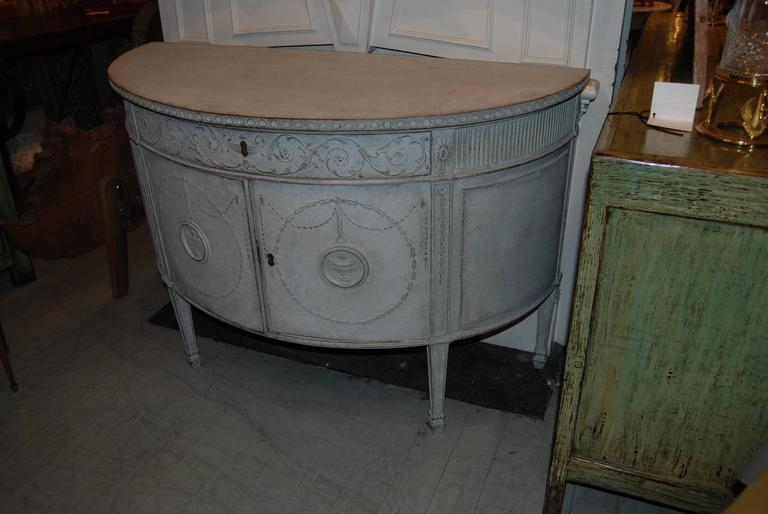 Beautiful painted and carved demilune buffet.