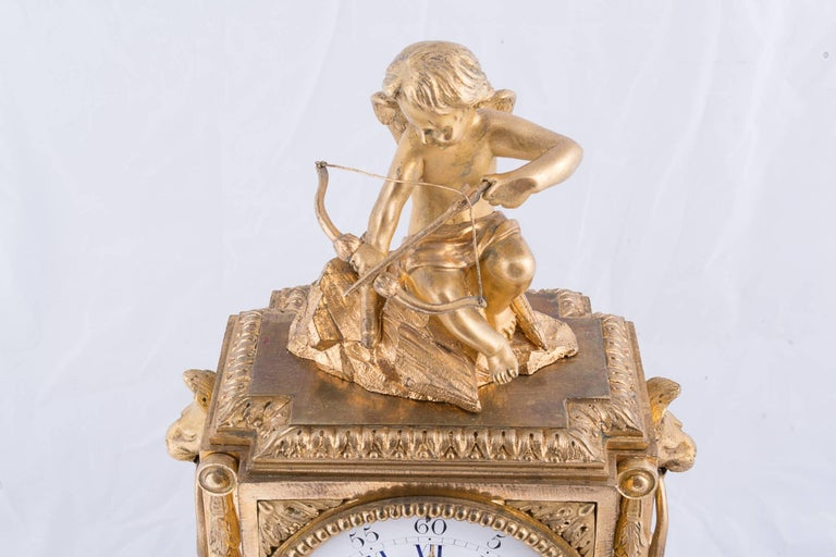 A beautifully detailed 19th century bronze dore clock with the figure of cupid on the top.
