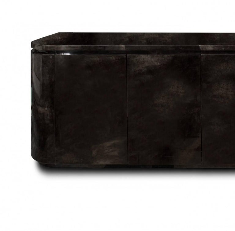Rare Karl Springer gem. A large, dark grey, lacquered goatskin sideboard / media unit with four doors, interior with some adjustable shelves, a drawer on right side and swivel platforms for media equipment, circa 1987 This piece is from an estate