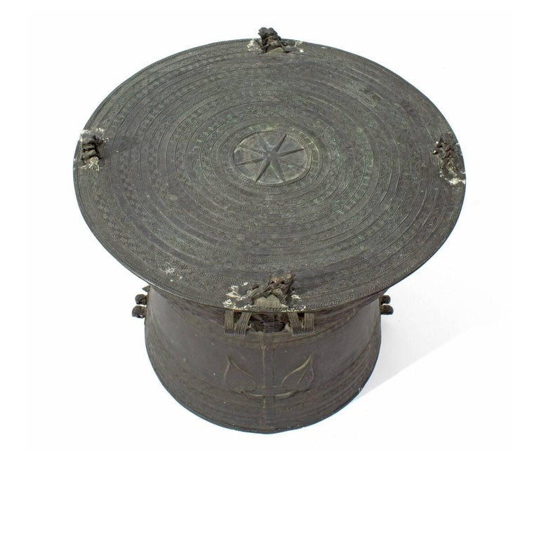 Vintage Asian bronze rain drum table. Ideal as an accent table or tall coffee table. May be used outdoors in a covered area. Measures: 20 inches wide x 15.5 inches high.