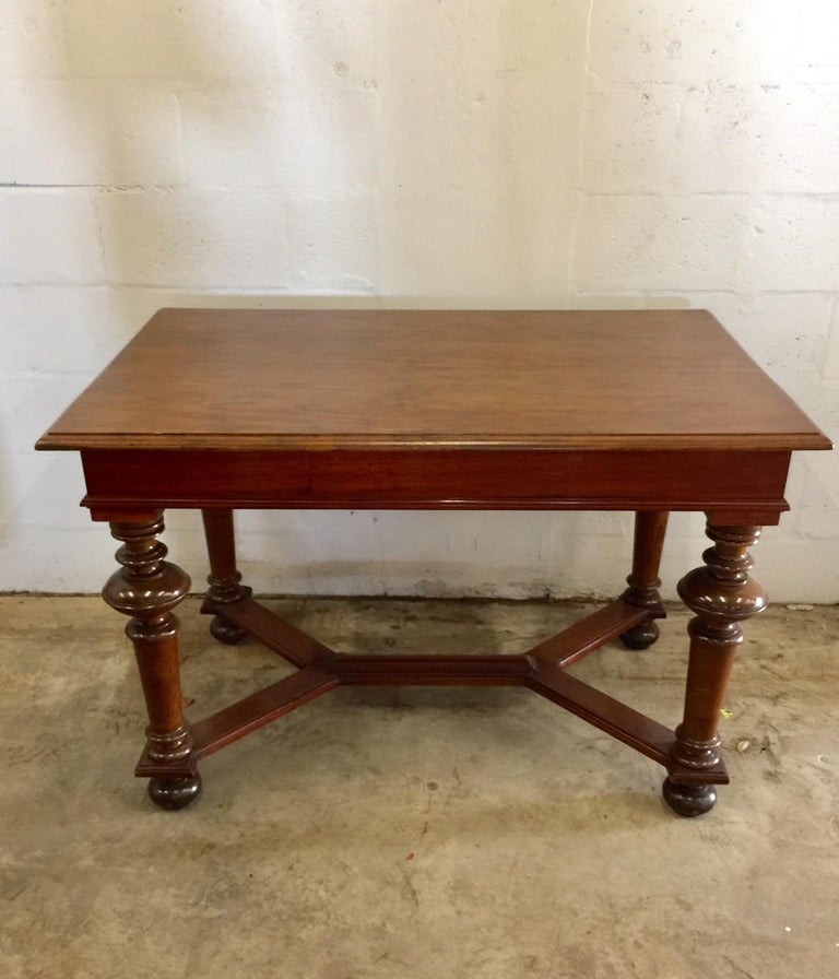 An walnut refectory table with X-shaped stretcher. England, circa 1940.