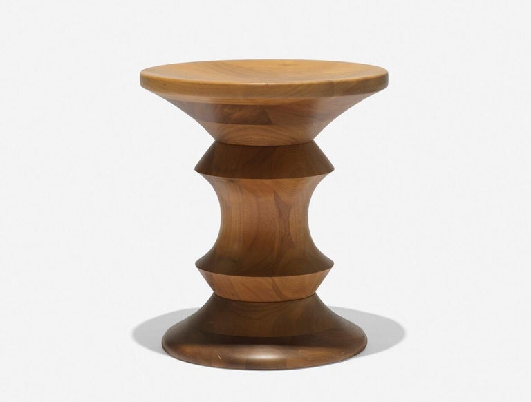 A lathe-turned wood stool by Charles and Ray Eames for Herman Miller, USA, circa 1950.  Ships from Hudson, NY.  Dimensions: 15 inches H x 13 inches W.