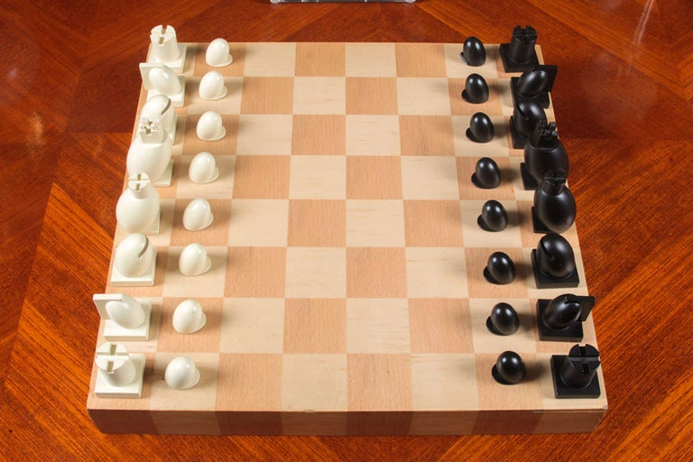 Carved wood chess and checkers set with board and box by famed architect Michael Graves. Chess board is marked with Graves tag; each chess and pawn piece is signed Graves; USA, circa 2000.