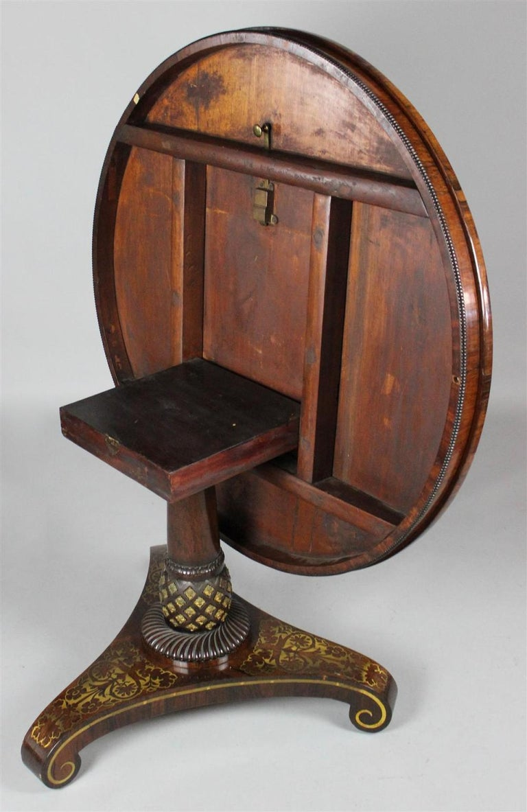 English Fine and Rare Form Rosewood and Brass Regency Tilttop Table For Sale