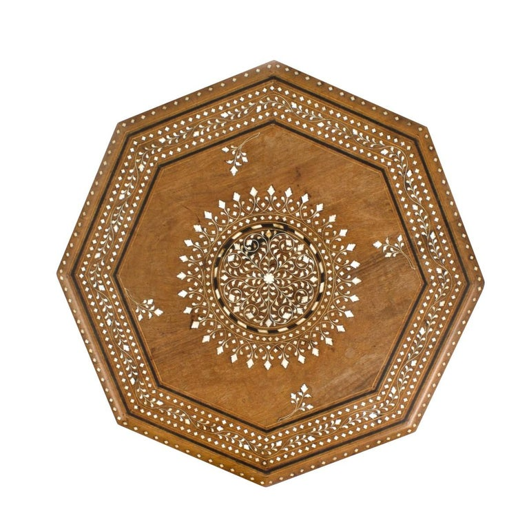 An Anglo-Indian folding octagonal side table featuring an inlaid design, circa 1950.