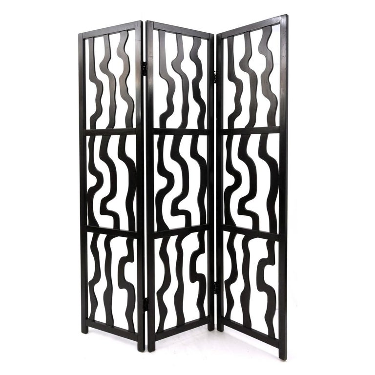 A contemporary sculptural three panel folding screen. Ebony finish, circa 2010.