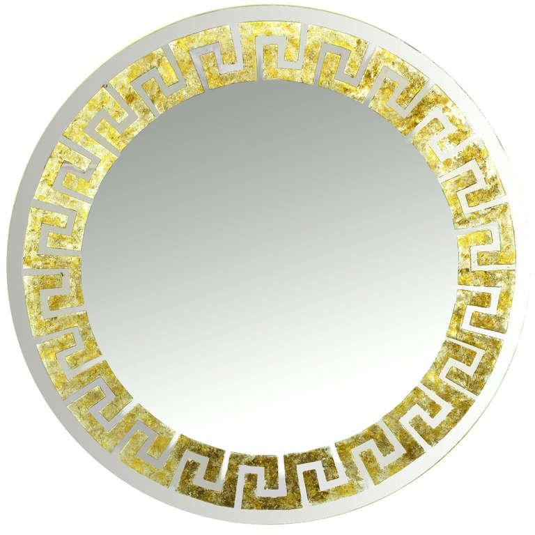 Pair of round, David Marshall signed mirrors with reverse gilt Greek key detail. Each segment of the Greek key design is reverse gilt with gold, silver and copper leaf. Mounted on a round wood backing.