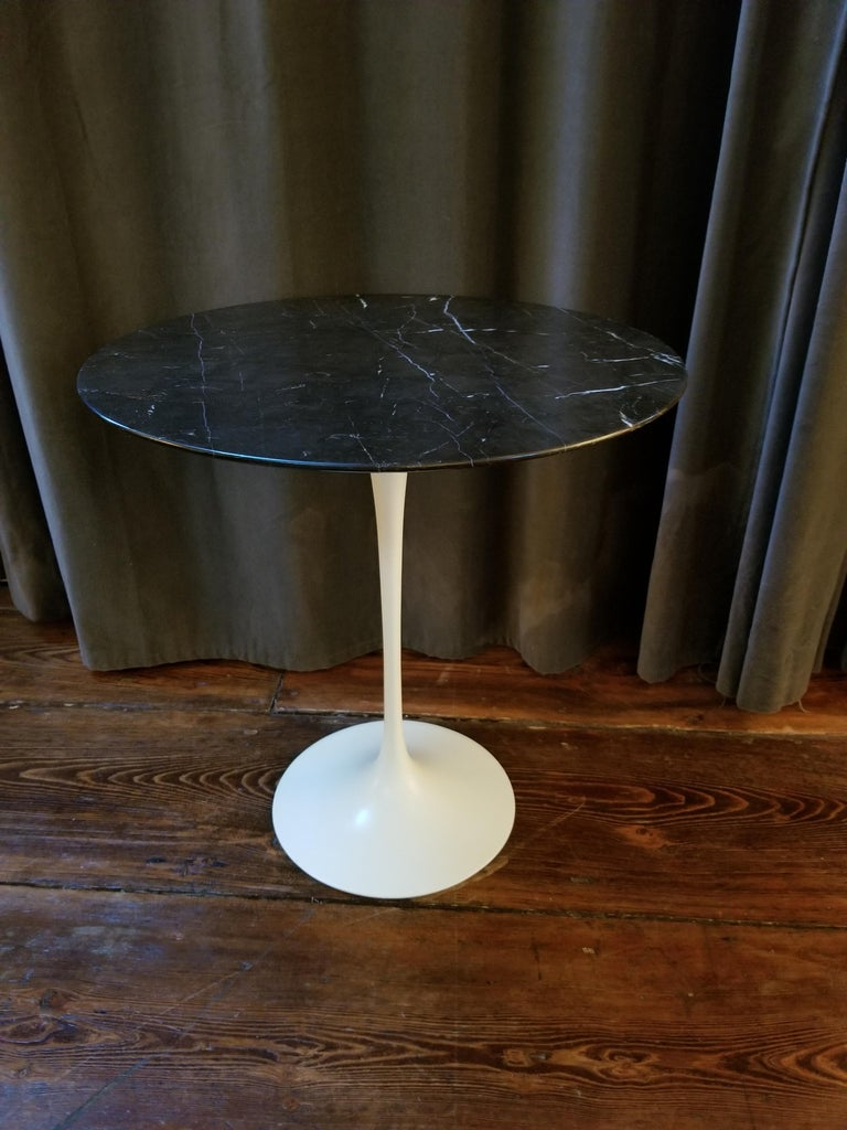 Eero Saarinen (1910–1961) Tulip side table with circular Nero marble top, white lacquered aluminum support and custom cut protective glass to place over marble.