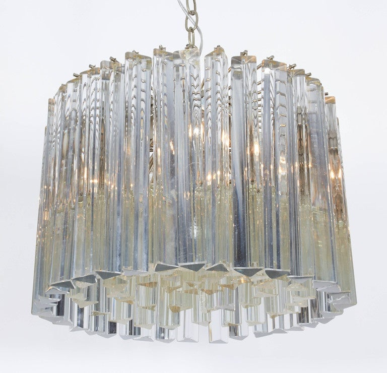 Crystal rod chandelier by Camer. Murano, Italy, circa 1950. An all original light fixture with a brushed steel metal frame. An outer row of 12-inch long crystal pendants surrounds inset rows of shorter crystals. Cleaned and newly required for U.S.;