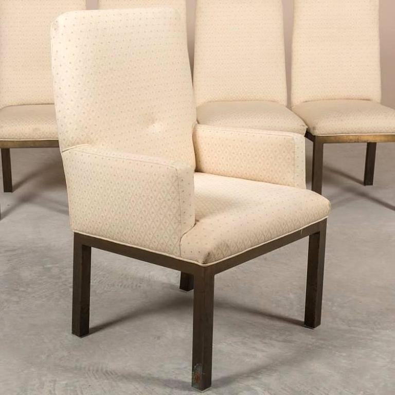 Group of six, bronze based, upholstered dining chairs by Mastercraft. Four-side and two-arm chairs. Very modern and comfortable, Should be reupholstered. COM available. Please see image of of a bronze dining table we have in inventory that would be