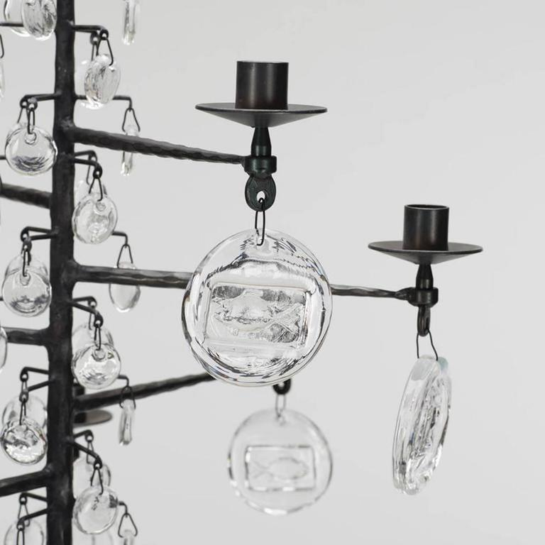 A twelve-arm candle lit chandelier designed by Erik Hoglund for Boda Smide. Provenance: Wells and Company
