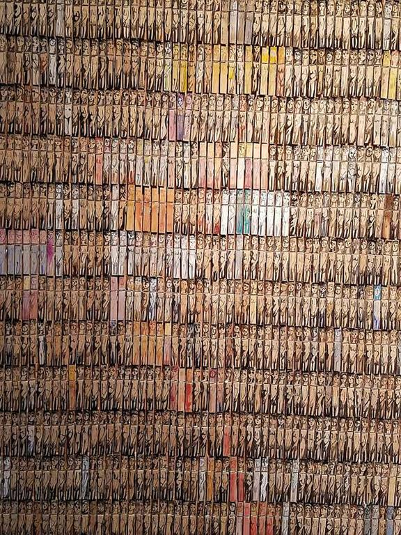 Using 1500 clothes pins to combine painting and sculpture to a dramatic affect is what artist Annie Morris is most famed for.  Each peg is individually painted using watercolours to create the naked female form. Her work usually encompasses lots of
