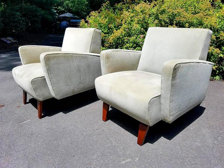 A very chic and comfortable pair of lounge chairs. Generous in proportion and sleek in design, these chairs look like they are moving even when they are standing still. The frames and interiors are solid and they are ready to use but they should be