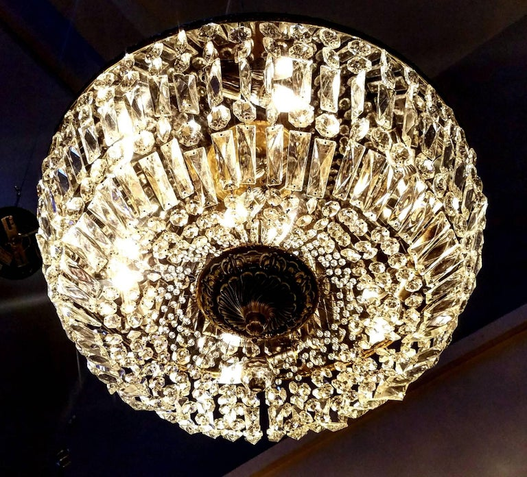 Best of quality. Made from heavy leaded crystal and bronze these 1950s basket chandeliers are just beautiful. Three of these are available, price is per item. They have been fully rewired and are ready for your home. Price and sold separately.