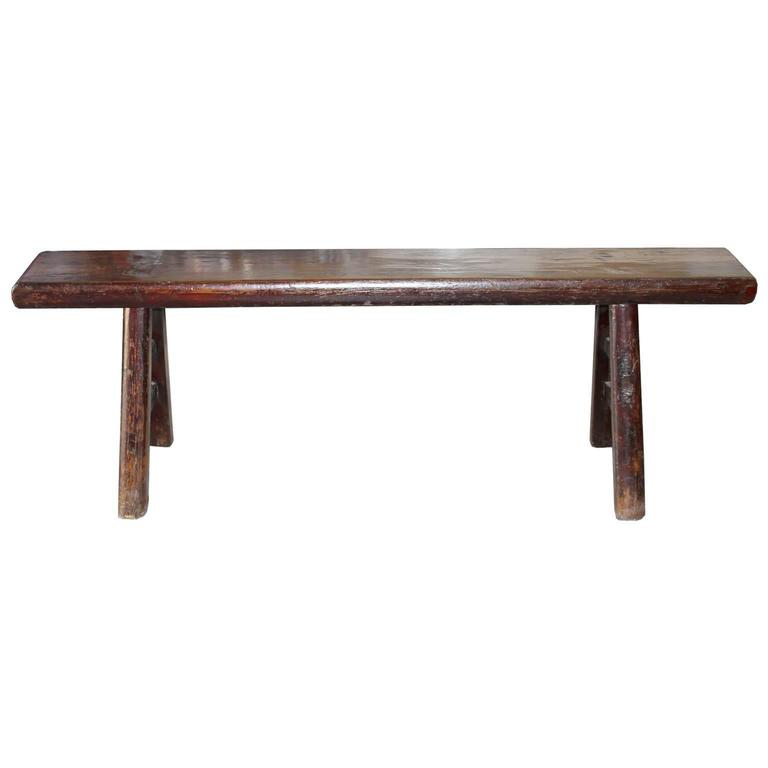 Vintage elmwood kung fu bench originally used to practice martial arts. Use at the end of a bed or as extra seating.