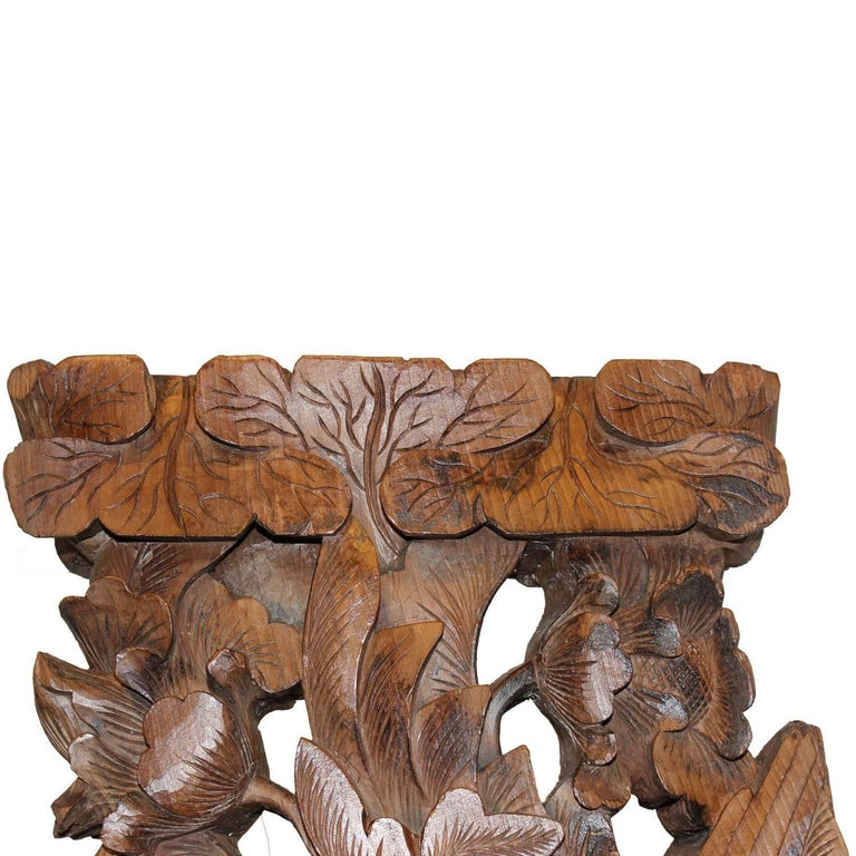 Hand-carved wood phoenix, a symbol of energy, strength and transformation. Originally an architectural element from a Chinese temple.