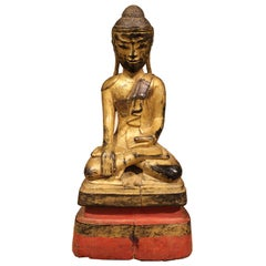 Gold and Red Sitting Monk