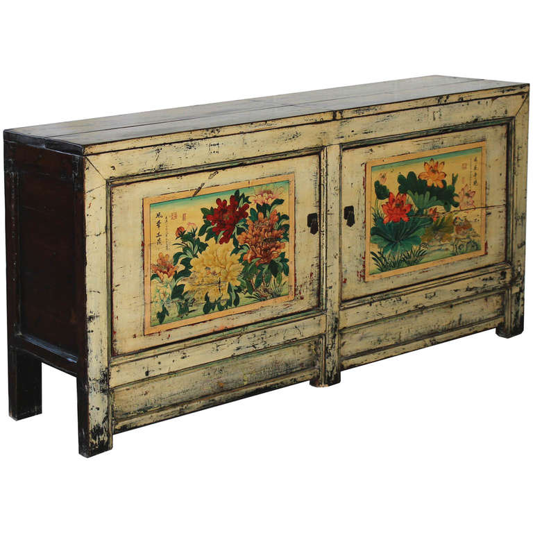 Elegant cream lacquer buffet with hand-painted bird and lotus and peonies flowers on the doors. Top opens up for easy storage. New interior shelves and hardware, Gansu, China, circa 1920s.