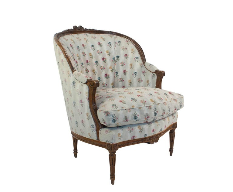 A large Louis XVI style fruitwood Bergere made in France, circa 1880. A Classic chair designed for comfort. Upholstery is older. Perfect for sitting by the fire and reading a book.