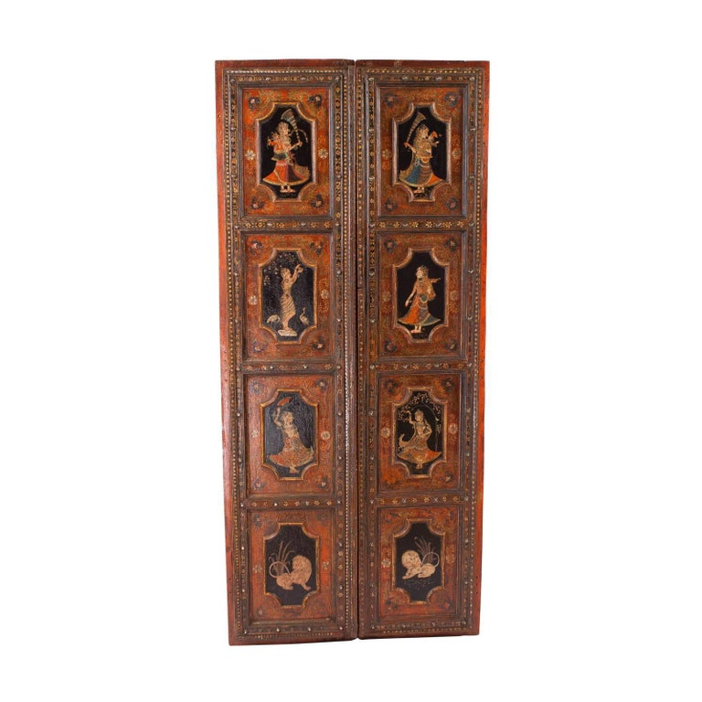 Pair of Indian painted palace doors circa 1830 decorated on both sides. Purchased from the estate of an antique dealer in the 1980s. Examples of these doors are difficult to find with original old painted decoration. Recently we had a thick coat of