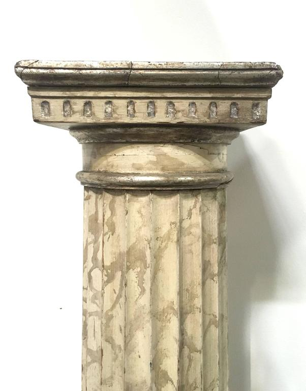 Late 18th century pair of Italian neoclassical parcel gilt and faux marble Doric columns. Each Hand-painted with Champagne leaf accents.