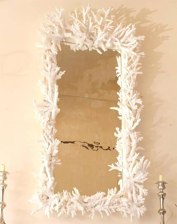 Custom Candace Barnes designed antiqued mirror with the larger branch coral on the top, and a mixture of larger and smaller specimens around the remaining frame. The branch coral is farm-raised and locally sourced. The mirror plate is antiqued with
