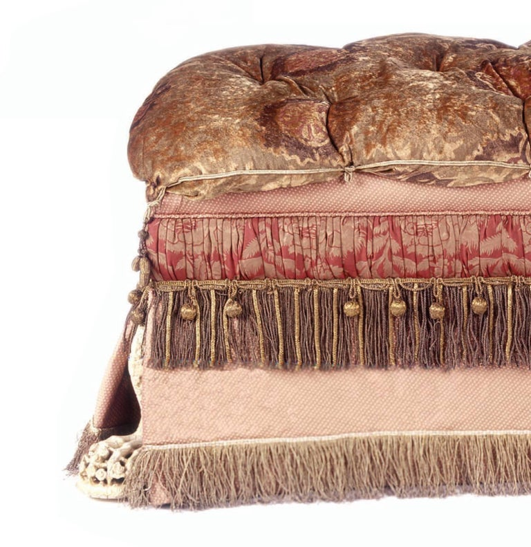 American Footed Ottoman, Upholstered in Various Fabrics with Antique Fringe and Trim For Sale