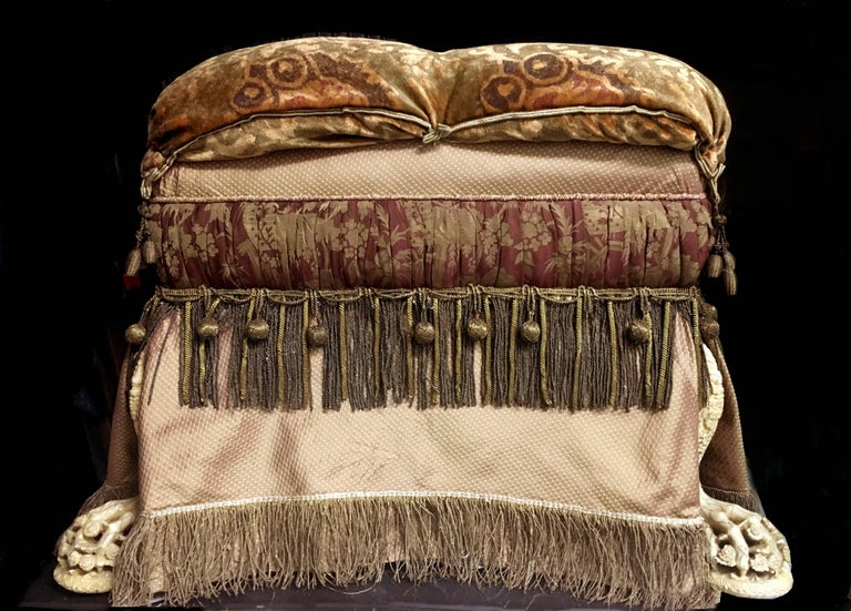 Footed Ottoman, Upholstered in Various Fabrics with Antique Fringe and Trim In Good Condition For Sale In San Francisco, CA
