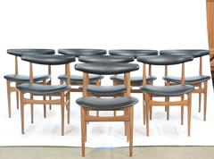A Set of 8 Danish Teak Compass-Back Dining Chairs in manner of Hans Wegner