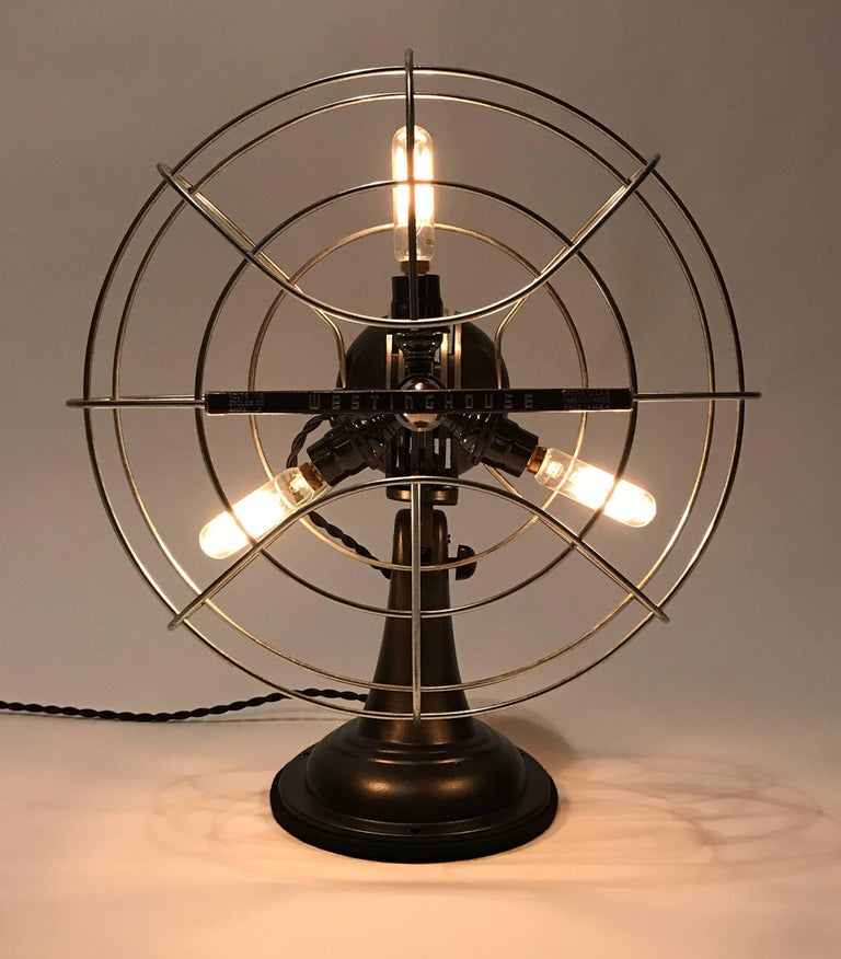 "Vintage 12"" Westinghouse fan repurposed as a lamp. The metal housing has been meticulously refinished and restored. 