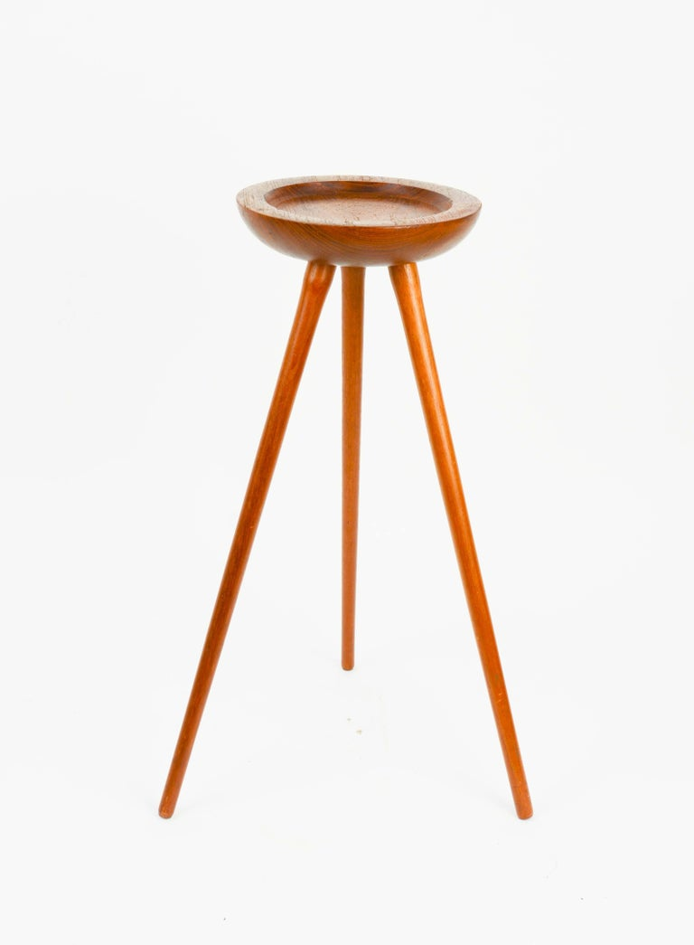 For the evening where you just want to rest and put your drink down. We have this tripod single cocktail table from Denmark in walnut.