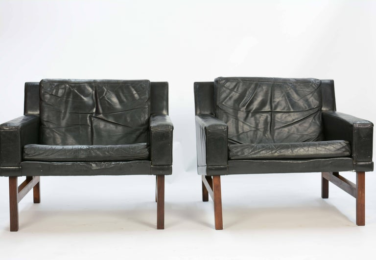 Rolschau Mobler's Club Chairs in distressed leather and floating rosewood frames by Sven Ellekaer.
