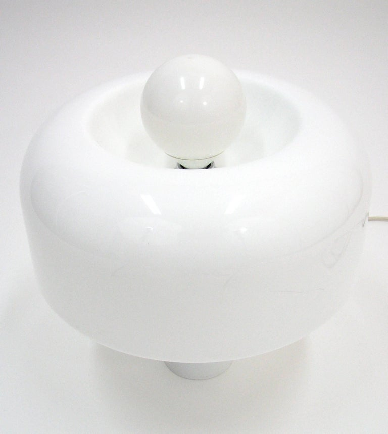 A rare all-white Brumbury table lamp designed by Luigi Massoni for Harvey Guzzini.