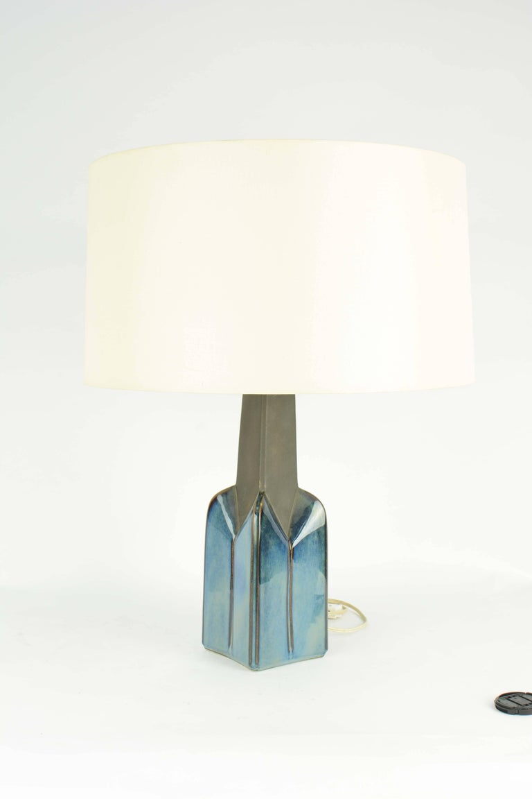 These beauties are hand glazed from Soholm factory in 1960s. They are both impressive and elegant in their presence and form. The lamps are sold without shades and can to rewired for an addition cost. Please look at the all the photos because the