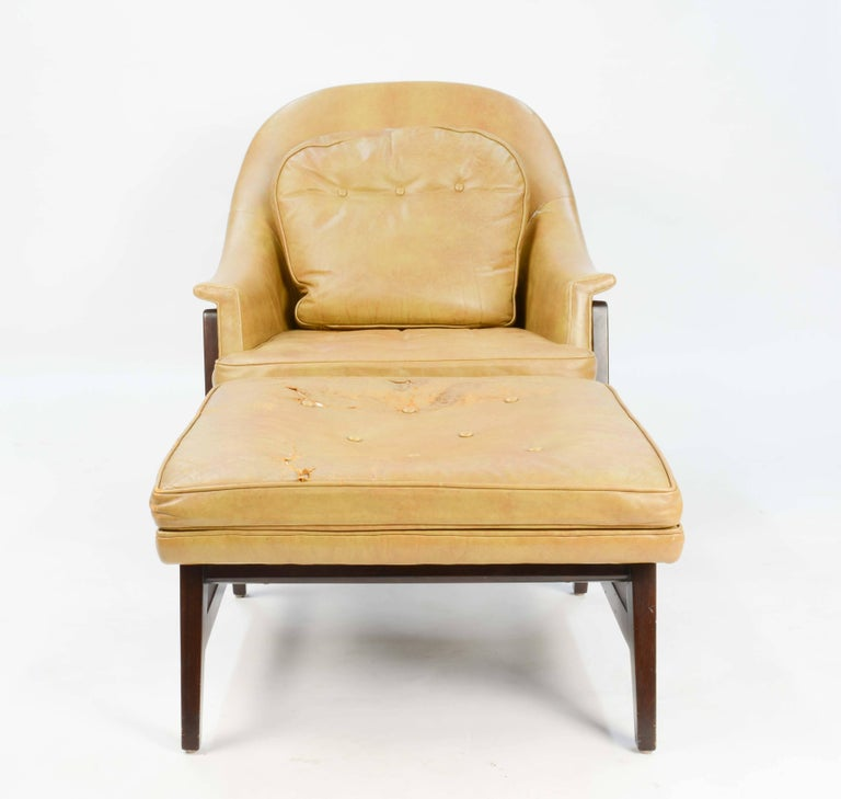 The iconic set is from Wormley's prestigious Janus Group line. This line is the best of Wormley's work of Dunbar Furniture Company. Both the chair and ottoman are all original and shows signs of wear and distress to the leather. The ottoman measures