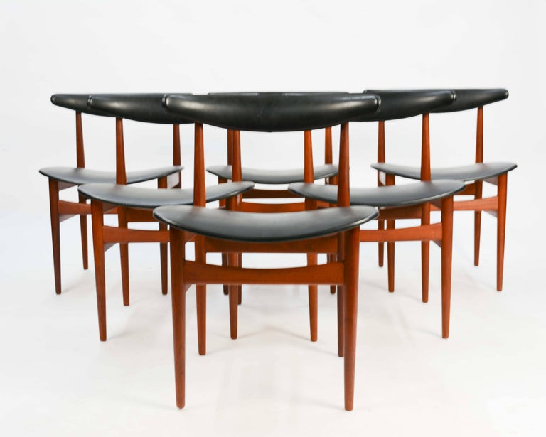 The Model 218A's in the manner of Poul Hundevad for Vamdrup Stolefabrik, Denmark, 1965. The chairs are in excellent vintage condition. The surround backs and wide seats make these chairs and excellent choice for those who want to entertain long