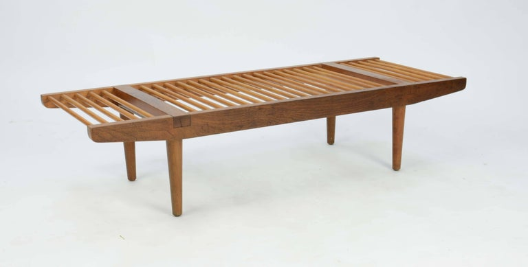 Milo Baughman's for Glenn of California large dowel bench, circa late 1950s. This lovely piece of early California modern that uses walnut and maple for contrasting colors.