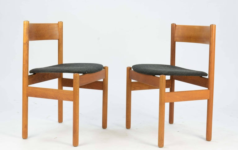 A set of four FDB Mobler of Denmark dining chairs that appear to have floating seat and sculpted contoured back in teak and oak. The chairs are labelled with the early FDB brand.