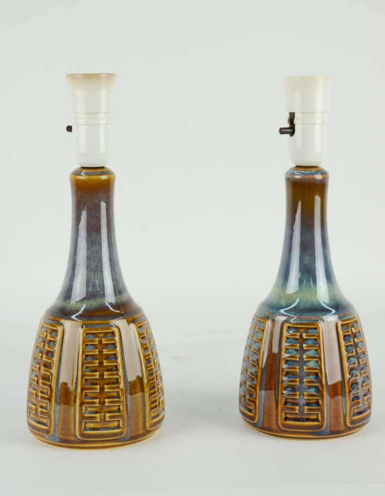 A fine example of Johansen's work for Soholm Stentj of Denmark The blue glazed hand glazed bodies have a rich lusher that is not found in current glazed. A beautiful pair of Danish modern design. They are sold without shades and can be rewired for