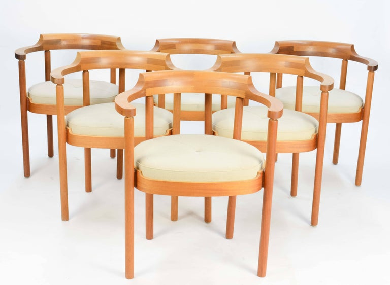 A finely made set of six oak arm chairs by Henning Jensen & Torben Valeur for Munch of Denmark. Each chairs has detailed jointed back in a semi compass surround back.