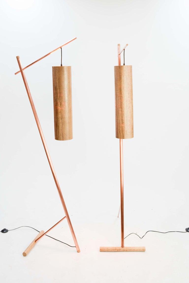 A pair of stylist and elegant floors lamps by seasoned art James Violette. The pair have a uniformed blended Aesthetic of old world craftmanship and new world technology. The simplistic design gives clear nods to Japanese modernism and Italian use