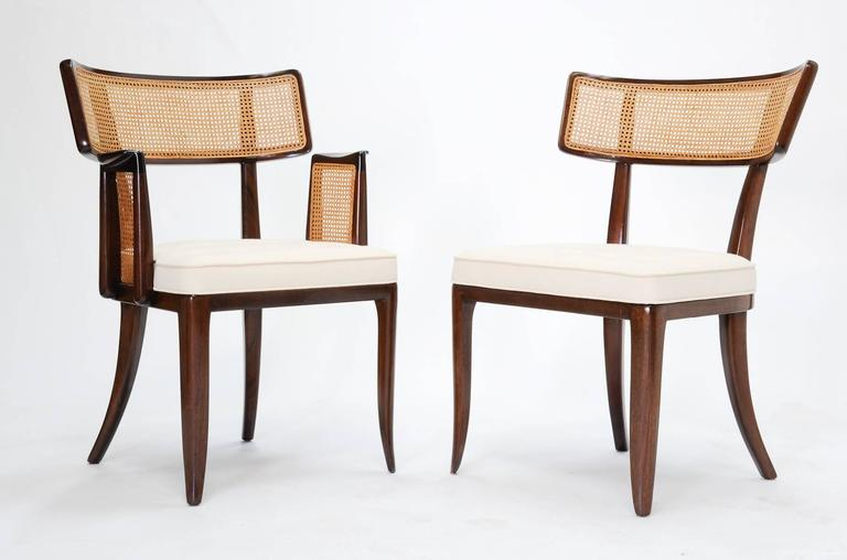 A large set of Dunbar chairs designed by Edward Wormley. The set can be broken up into a smaller set of ten if needed. The arm height is 26.75. Price is higher for the arm arm chairs $3250 each