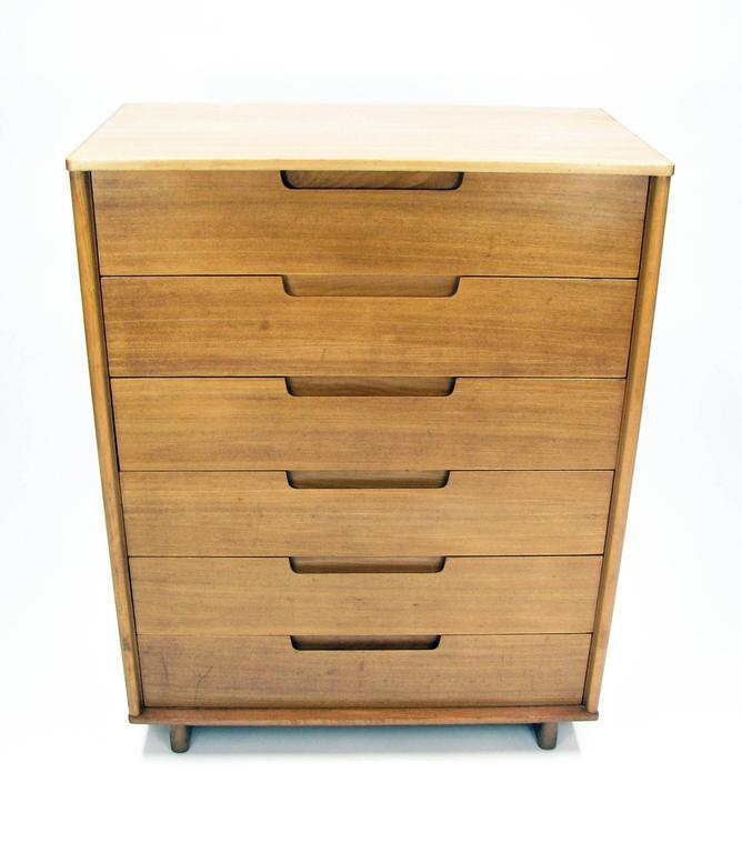 "This handsome Mid-Century chest of drawers is an important early piece by Milo Baughman, created for Drexel ""Today's Living"" collection. This six-drawer dresser was produced in figured elmwood in 1953 (stamped documentation on the back). The top"